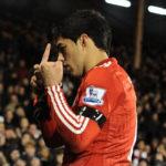 Luis Suarez shows his middle finger