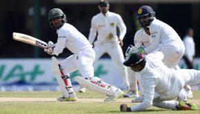 Bangladesh cricketer Imrul Kayes plays a shot as Sri Lankan wicketkeeper Niroshan Dickwella