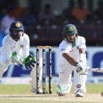 Bangladesh cricketer Sabbir Rahman plays a shot as Sri Lankan wicketkeeper Niroshan Dickwella