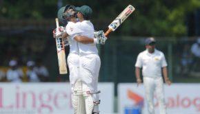Bangladeshi batsman Shakib Al Hasan, left, celebrates scoring a century as teammate Mosaddek Hossain