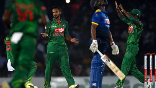 Bangladesh cricketer Shakib Al Hasan celebrates with teammates after he dismissed Sri Lankan cricketer Asela Gunaratne