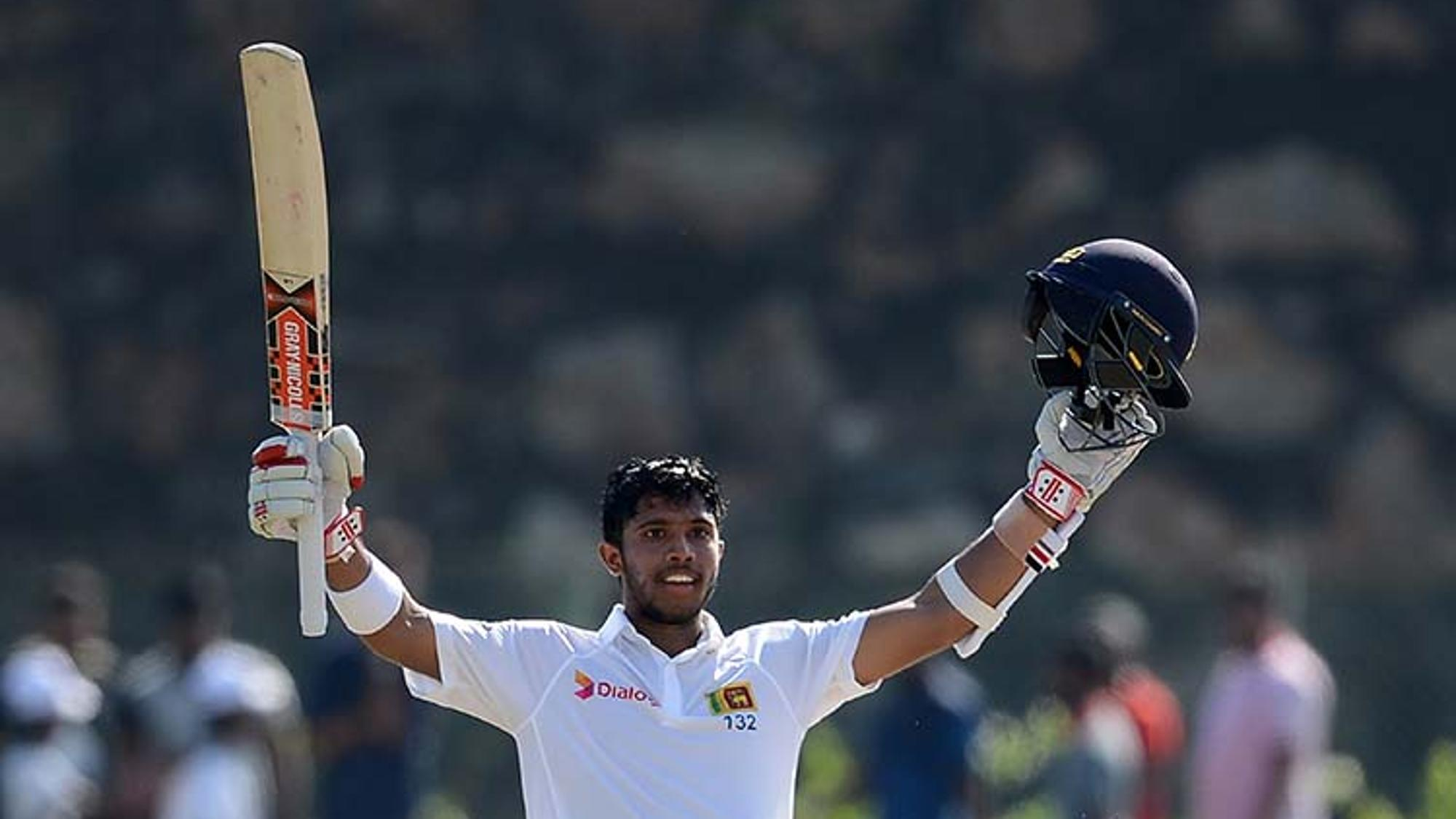 Kusal_Mendis_celebrates_reaching_his_century_on_Day_1_in_Galle
