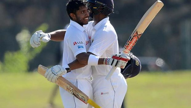Kusal_Mendis_is_congratulated_by_Asela_Gunaratne_for_his_gritty_century_