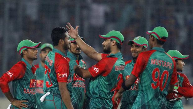 Bangladesh's Shakib Al Hasan, second left, celebrates with teammates the dismissal of Zimbabwe's Craig Ervine