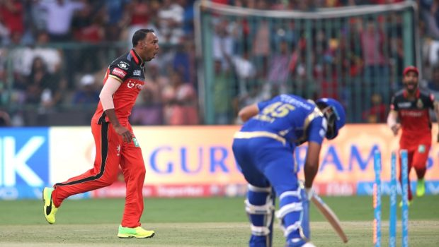 Samuel Badree of the Royal Challengers Bangalore celebrates bowling Mumbai Indians captain Rohit Sharma