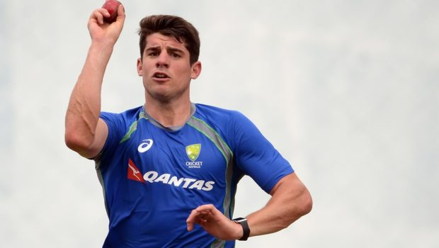 Australian cricketer Moises Henriques delivers a ball during a practice session