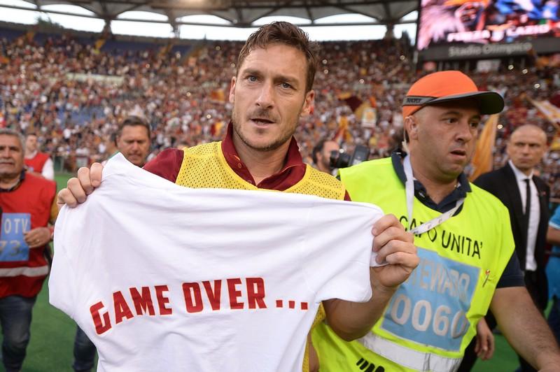Roma's forward Francesco Totti shows a tee-shirt