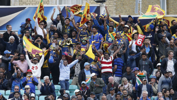 Sri Lankan supporters celebrate a boundary during the ICC Champions Trophy