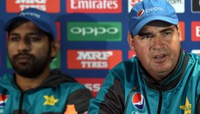 Pakistan coach Mickey Arthur (R) and captain Sarfraz Ahmed attend a press conference