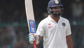 India's Rohit Sharma raises bat after scoring fifty runs