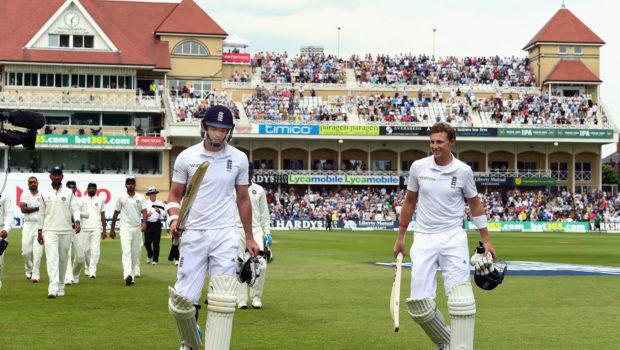 England batsman Joe Root and James Anderson leave the field