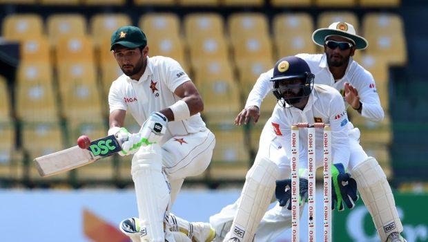 Zimbabwe's cricketer Sikandar Raza plays a shot as Sri Lankan wicketkeeper Niroshan Dickwella