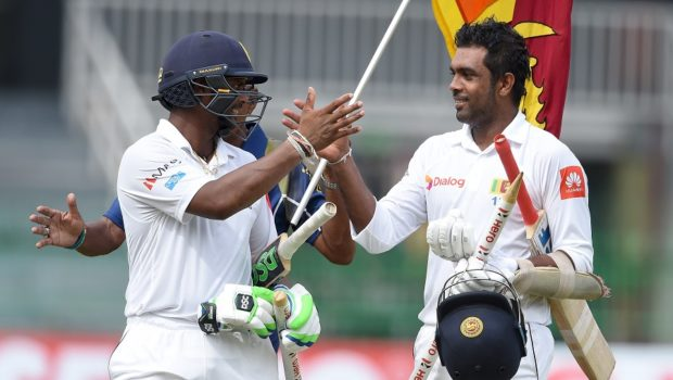 Sri Lankan cricketer Asela Gunaratne (R) and Dilruwan Perera