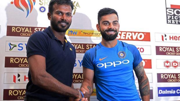 Indian cricket team captain Virat Kohli (R) shakes hands with Sri Lankan one-day international (ODI) and Twenty20 captain Upul Tharanga