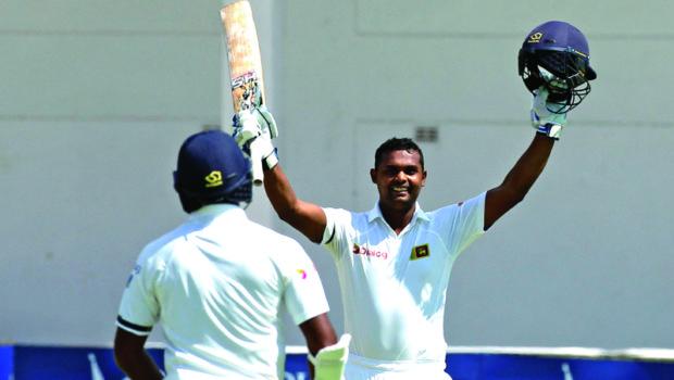 Sri Lanka batsman Asela Gunaratne celebrates after scoring 100