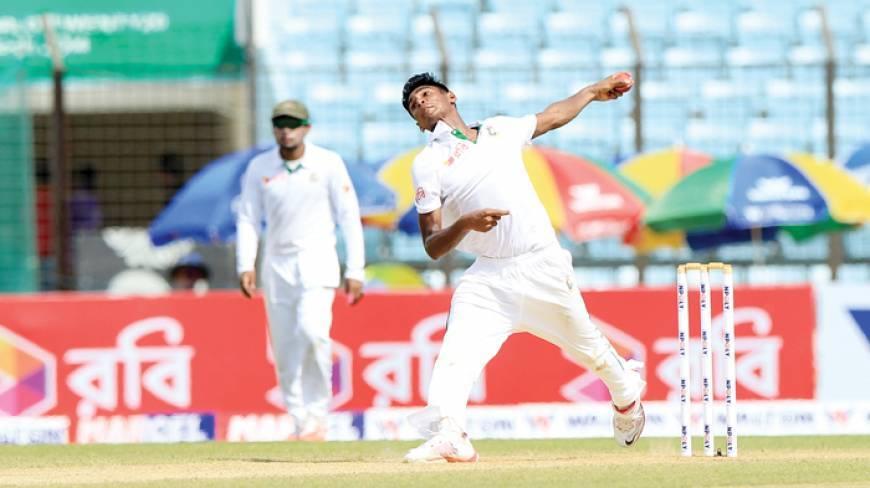 Mustafizur Rahman of Bangladesh celebrates after taking the wicket of Matthew Wade