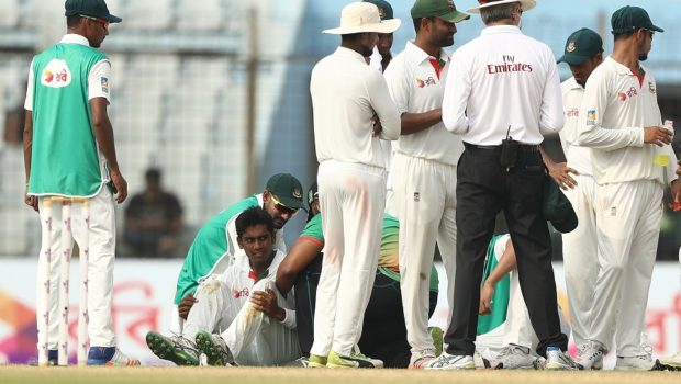 Mehedi Hasan Miraz of Bangladesh is checked after he was struck by a shot from Hilton Cartwright