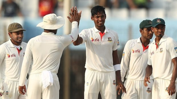 Mustafizur Rahman of Bangladesh celebrates after taking the wicket of Matthew Wade