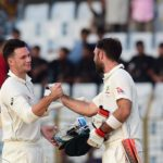 Australian cricketers Peter Handscomb (L) and Glenn Maxwell (R) celebrate after winning the second cricket Test