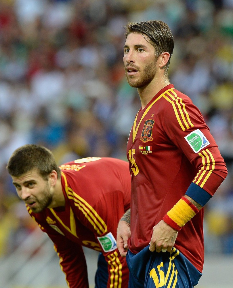 Sergio Ramos of Spain (R) looks on with Gerard Pique during the FIFA Confederations Cup Brazil 2013 Semi Final