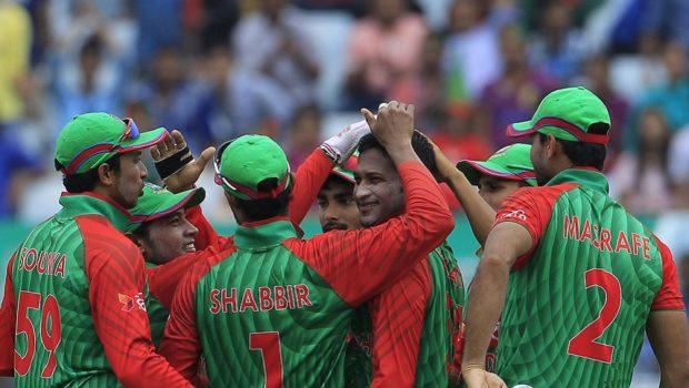 Bangladesh cricketers congratulate Shakib Al Hasan (C) after the dismissal of South African captain Hashim Amla