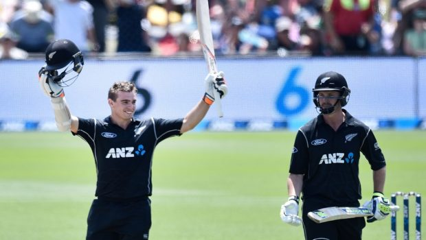 New Zealand's Tom Latham (L) celebrates his century as teammate Colin Munro