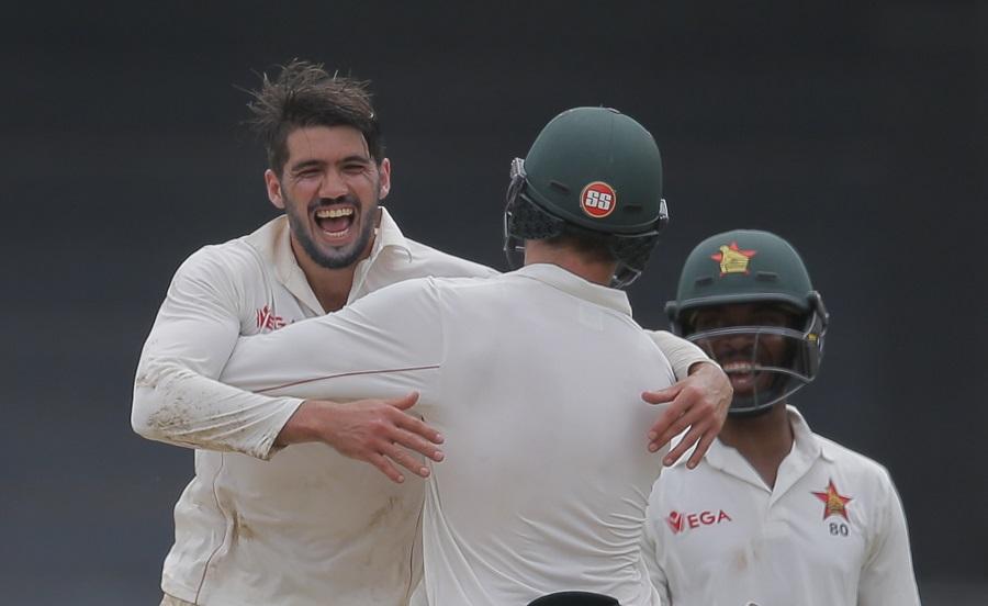 Zimbabwe's captain Graeme Cremer celebrates the dismissal of Sri Lanka's Angelo Mathews