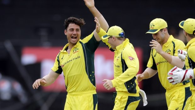Australia cricket player Marcus Stoinis, left celebrates with Captain Steven Smith after Rohit Sharma's wicket