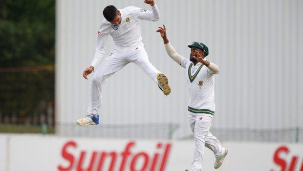 South African bowler Keshav Maharaj (L) celebrates the dismissal of Bangladesh batsman Mushfiqur Rahim