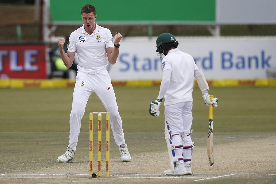 South African bowler Morne Morkel (L) celebrates the dismissal of Bangladeshi batsman Mominul Haque