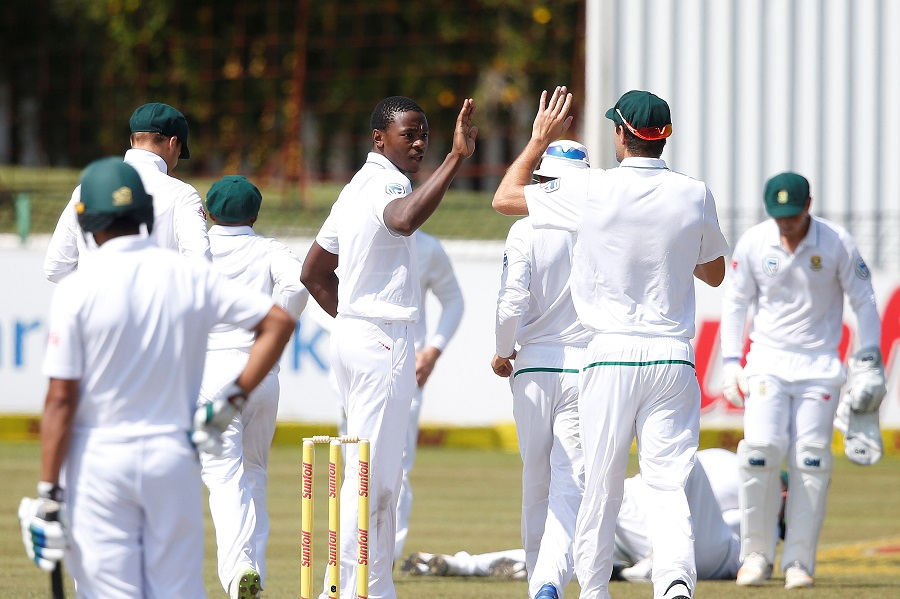 South African bowler Kagiso Rabada celebrates the dismissal of Bangladesh batsman Mushfiqur Rahim