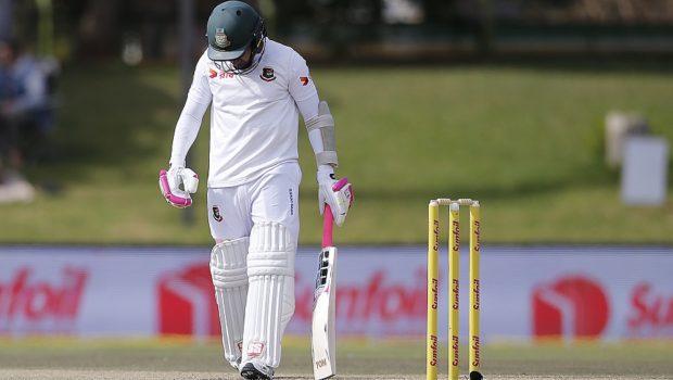 Bangladesh batsman Mushfiqur Rahim leaves the ground after South Africa fielder Temba Bavuma caught him out