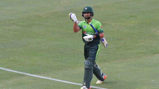 Pakistan's Ahmed Shehzad leaves the field after being dismissed by Lahiru Gamage