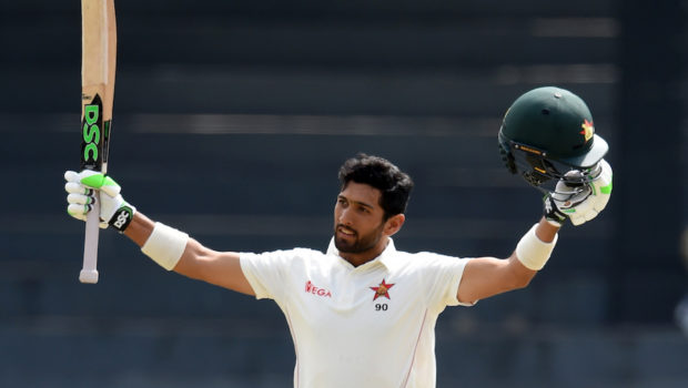 Zimbabwe's batsman Sikandar Raza celebrates after scoring a century