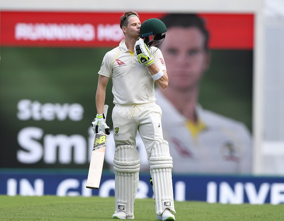 Smith kisses his helmet after hundred