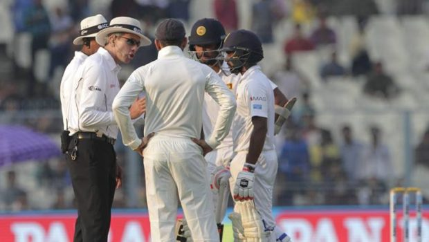 India's captain Virat Kohli, back to camera, Sri Lanka's captain Dinesh Chandimal