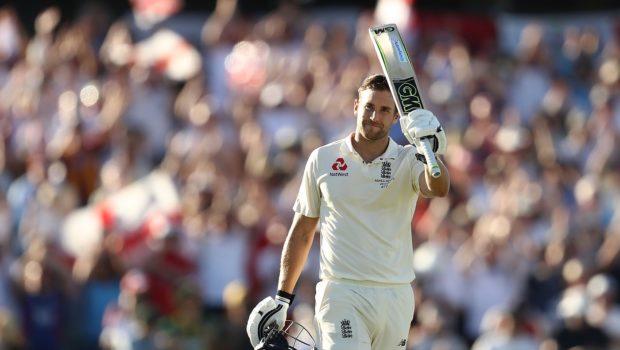 Dawid Malan of England celebrates after reaching his century
