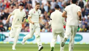 Chris Woakes of England celebrates taking the wicket of David Warner