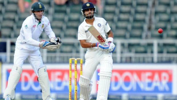 Indian-batsman-Virat-Kohli-R-bats-next-to-South-African-wicket-keeper-AB-de-Villiers-on-the-third-day-of-a-cricket-Test-match-between-South-African-and-India1