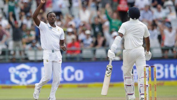 South African bowler Kagiso Rabada (L) celebrates the dismissal of Indian batsman Virat Kohli