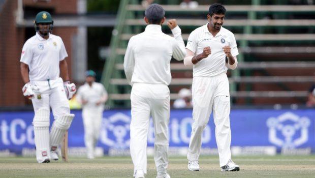 Indian bowler Jasprit Bumrah (R) celebrates the dismissal of South African batsman Hashim Amla