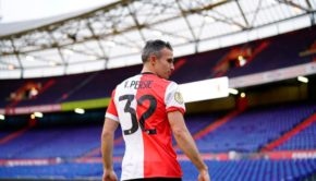 Robin van Persie is pictured on the pitch of De Kuip stadium, after the Dutch player signed a contract with Feyenoord, in Rotterdam