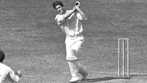 Australian Services' Keith Miller hits another boundary in his innings of 105