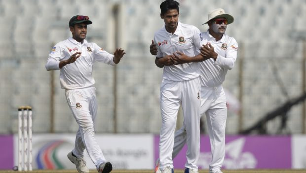 Bangladesh's Mustafizur Rahman, center, celebrate with his teammates Imrul Kayes, and Mehidy Hasan