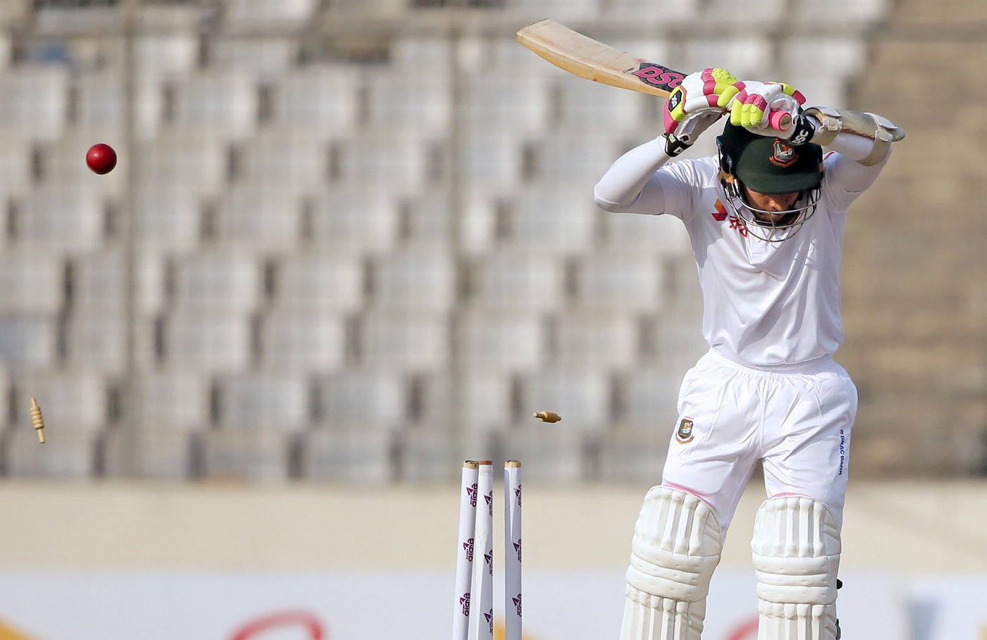 Bangladeshi cricketer Mushfiqur Rahim reacts after being dismissed