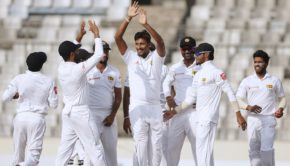 Sri Lankan cricketer Suranga Lakmal celebrates with teammate