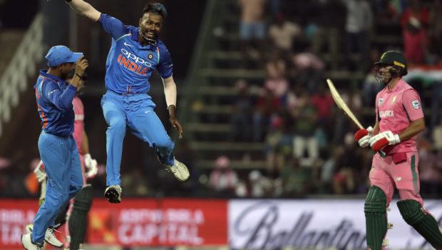 India's bowler Hardik Pandya, middle, celebrates with teammate Yuzvendra Chahal