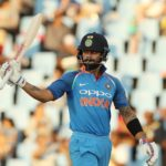 Virat Kohli (captain) of India celebrates his half century