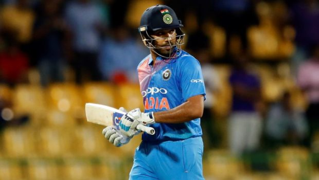 India's Rohit Sharma looks back as he walks off the field after his dismissal