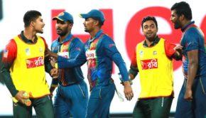 Bangladesh's Nurul Hasan, right, exchanges words with Sri Lanka's skipper Thisara Perera